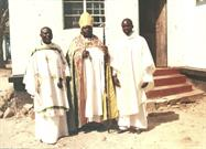After Fr. Sylvester's induction Service on 14th July. The Bishop is in the middle and he is on the left